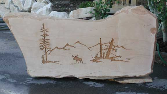 Yard art piece carved in stone natural rock designs